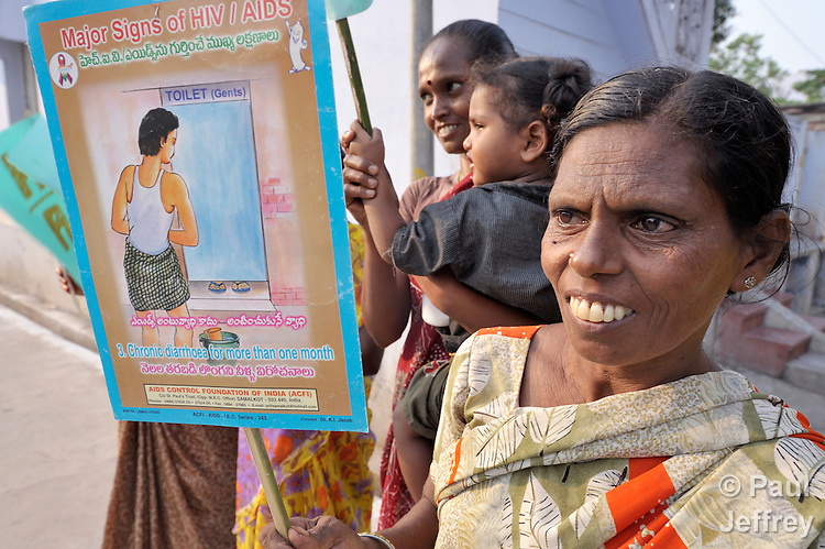 SK Vayuddin, a 35-year old woman living with HIV, demonstrates with other women against stigma and discrimination on the street in Chilakaluripet, a town in Andhra Pradesh, India. (Note Special Instructions below.)