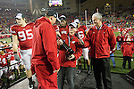 University of Wisconsin-Madison Chancellor David Wiley presents the Leaders Division Trophy to Wisconsin Badgers Head Coach Bret Bielema after an NCAA Big Ten Conference college football game against the Penn State Nittany Lions on November 26, 2011 in Madison, Wisconsin. The Badgers won 45-7. (Photo by David Stluka)