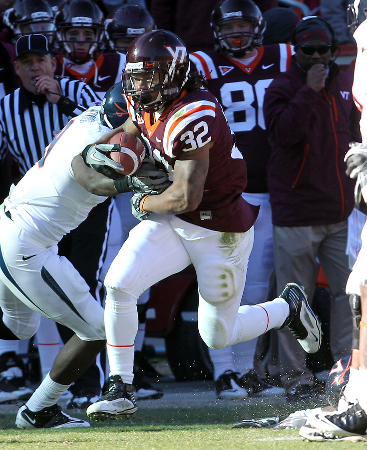Nov 27, 2010; Charlottesville, VA, USA; Virginia Tech Hokies running back Darren Evans (32) during the game against the Virginia Cavaliers at Lane Stadium. Virginia Tech won 37-7. Mandatory Credit: Andrew Shurtleff