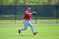 Philadelphia Phillies outfielder Cord Sandberg (24) tracks a fly ball during a minor league spring training game against the Pittsburgh Pirates on March 18, 2014 at the Carpenter Complex in Clearwater, Florida.  (Mike Janes/Four Seam Images)