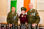 Sergeant Chris Hoare,  and Gunner James Power, with Davey J Flaherty. who's dad is in the Amy, Dave Flaherty based at Collins Barricks at the presentation of the   tricolour and Proclamation at Holy Family School Tralee to commemorate the 100 year anniversary on Monday