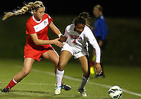 BOYDS, MARYLAND - April 06, 2013:  Julia Roberts (13) of The Washington Spirit holds onto Morgan Stith (4) of the University of Virginia women's soccer team in a NWSL (National Women's Soccer League) pre season exhibition game at Maryland Soccerplex in Boyds, Maryland on April 06. Virginia won 6-3.