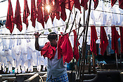 A washerman (locally known as Dhobis) dries laundry in Dhobighat, the world's largest laundomat in India's financial capital, Mumbai, India.