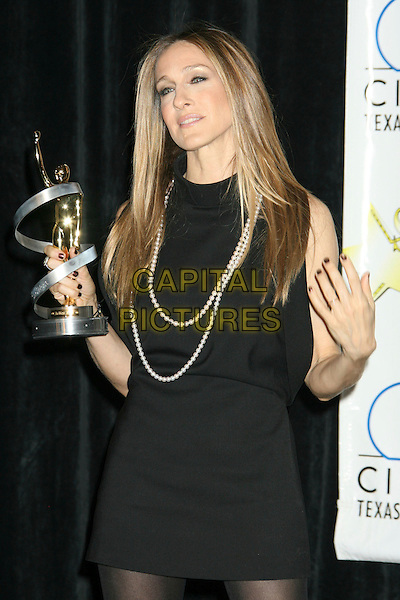 SARAH JESSICA PARKER. 2008 ShoWest Awards Ceremony held at the Paris Las Vegas Hotel. ShoWest is the official convention of the National Association of Theatre Owners.,Las Vegas, Nevada , USA, 13 March 2008..half length black dress  award trophy hands nail varnish polish.CAP/ADM/RE.©Russ Elliot/Admedia/Capital PIctures