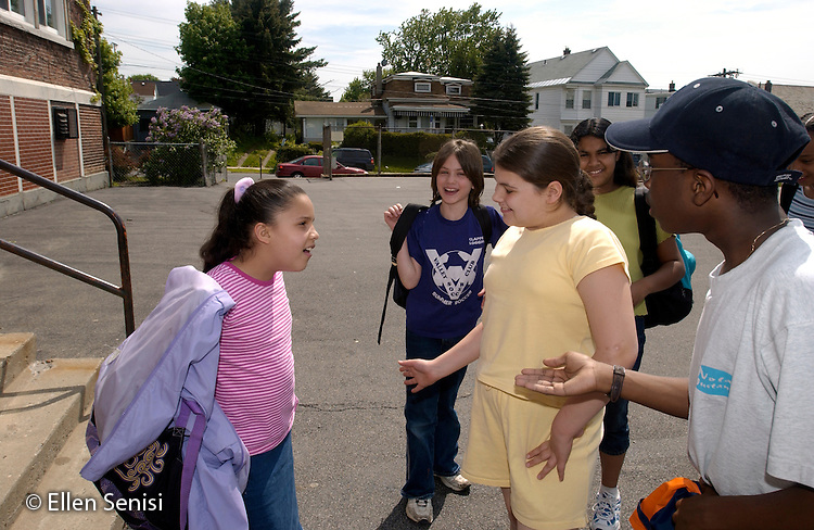 MR / Schenectady, NY. Yates Arts in Education Magnet School / urban public elementary school / Grade 5.Students talk, hang out on playground at dismissal time..MR: AD-g5a..© Ellen B. Senisi