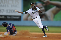 Asheville Tourists shortstop Rosell Herrera #29 throws to first during a game against the Rome Braves at McCormick Field on June 23, 2012 in Asheville, North Carolina.  The Braves defeated the Tourists 4-2. (Tony Farlow/Four Seam Images).