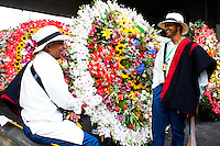 Men talks before the start of the 58th Silleteros' parade in the framework of the flowers' fair, this year the silleteros parade was declared intangible heritage of Colombia. Medellín, Colombia 09/08/2015
