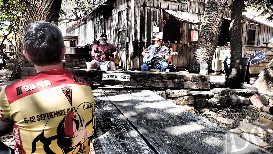 NWA Democrat-Gazette/FLIP PUTTHOFF <br /> Bike riders enjoy music and barbecue in Luckenbach, Texas during a Texas Hill Country cycling trip.