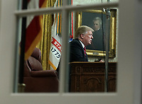 President Donald Trump deliver a televised address to the nation from the Oval Office at the White House in Washington, DC on January 8, 2019.  Photo taken through the Oval Office windows.   The speech comes on the 18th day of a partial government shutdown cause by a dispute over a proposed border wall separating the United States and Mexico. <br /> CAP/MPI/RS<br /> &copy;RS/MPI/Capital Pictures
