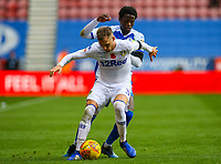 Leeds United's Barry Douglas holds off the challenge from Wigan Athletic's Leo Da Silva Lopes<br /> <br /> Photographer Alex Dodd/CameraSport<br /> <br /> The EFL Sky Bet Championship - Wigan Athletic v Leeds United - Sunday 4th November 2018 - DW Stadium - Wigan<br /> <br /> World Copyright &copy; 2018 CameraSport. All rights reserved. 43 Linden Ave. Countesthorpe. Leicester. England. LE8 5PG - Tel: +44 (0) 116 277 4147 - admin@camerasport.com - www.camerasport.com