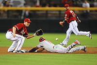 Jul. 28, 2009; Phoenix, AZ, USA; Philadelphia Phillies baserunner Jimmy Rollins steals second base in the first inning ahead of the tag by Arizona Diamondbacks shortstop Stephen Drew at Chase Field. Mandatory Credit: Mark J. Rebilas-
