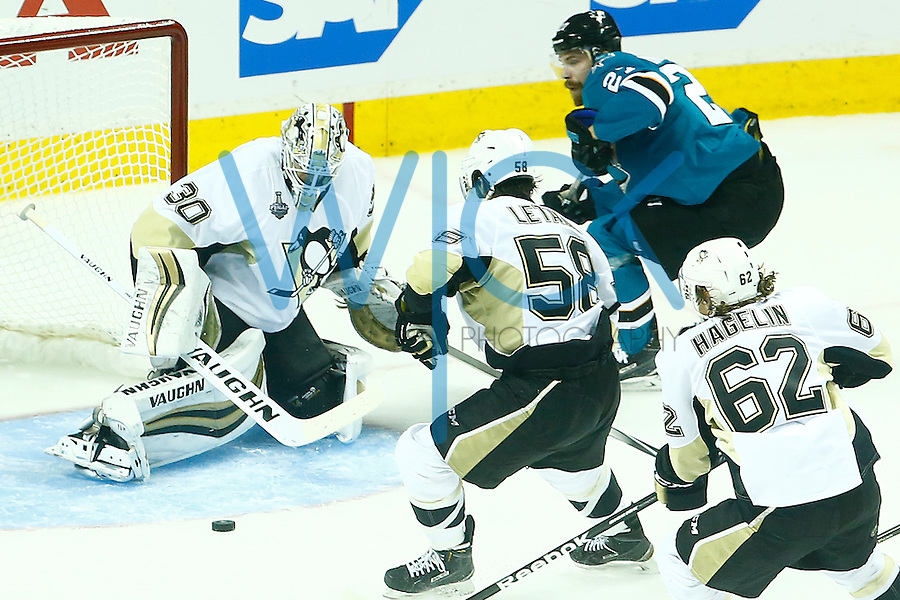 Matt Murray #30 of the Pittsburgh Penguins makes a save in front of Joonas Donskoi #27 of the San Jose Sharks during game three of the Stanley Cup Final at the SAP Center in San Jose, California on June 4, 2016. (Photo by Jared Wickerham / DKPS)