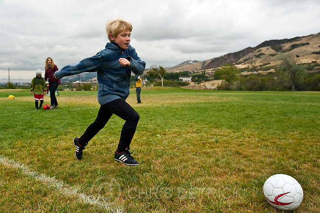 Chris Detrick  |  The Salt Lake Tribune.Jennifer Hyvonen watches her son Gabriel, 7, during a soccer practice at Donner Park Friday October 7, 2011.