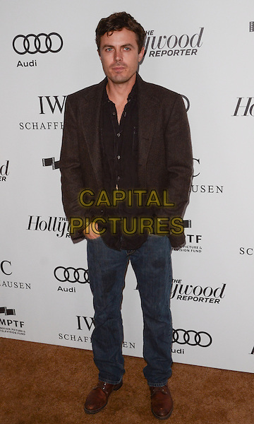 Casey Affleck.The Motion Picture & Television Fund Presentation of 'Reel Stories Real Lives'  held at Milk Studios, Los Angeles, California, USA, 20th October 2012..full length brown shirt jacket jeans hands in pockets shoes .CAP/ADM/TW.©Tonya Wise/AdMedia/Capital Pictures.