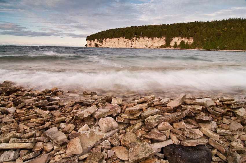 Limestone bluffs and Lake Michigan waves at Fayette State Historical Park near Garden Michigan.