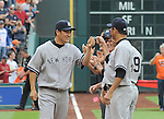 (L-R) Masahiro Tanaka, Hiroki Kuroda (Yankees),<br /> APRIL 1, 2014 - MLB :<br /> Masahiro Tanaka of the New York Yankees gets a fist-bump from his teammate Hiroki Kuroda during introductions before the baseball game against the Houston Astros at Minute Maid Park in Houston, Texas, United States. (Photo by AFLO)