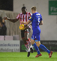 Lincoln City's John Akinde vies for possession with Morecambe's Steven Old<br /> <br /> Photographer Chris Vaughan/CameraSport<br /> <br /> The EFL Sky Bet League Two - Saturday 15th December 2018 - Lincoln City v Morecambe - Sincil Bank - Lincoln<br /> <br /> World Copyright © 2018 CameraSport. All rights reserved. 43 Linden Ave. Countesthorpe. Leicester. England. LE8 5PG - Tel: +44 (0) 116 277 4147 - admin@camerasport.com - www.camerasport.com