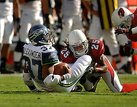 Nov. 6, 2005; Tempe, AZ, USA; Running back (37) Shaun Alexander of the Seattle Seahawks is tackled by cornerback (25) Eric Green of the Arizona Cardinals at Sun Devil Stadium. Mandatory Credit: Mark J. Rebilas