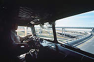 Texas, 1978. Driver for Frozen Food Express. This is a very hard job because transport is timely and he drives most of the nights.