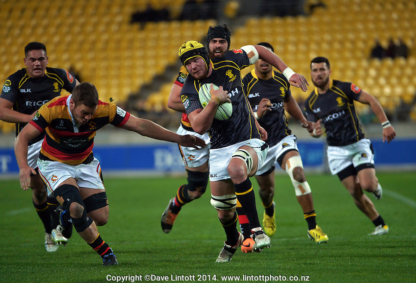 Adam Hill takes the ball up during the ITM Cup rugby union match between Wellington Lions and Waikato at Westpac Stadium, Wellington, New Zealand on Saturday, 16 August 2014. Photo: Dave Lintott / lintottphoto.co.nz