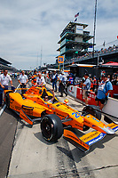 May 26, 2017; Indianapolis, IN, USA; Crew members tow the car of IndyCar Series driver Fernando Alonso to the garage at the end of Carb Day for the 101st Running of the Indianapolis 500 at Indianapolis Motor Speedway. Mandatory Credit: Mark J. Rebilas-USA TODAY Sports