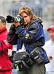 26 September 2010: Associated Press photographer Ann Heisenfelt takes pre-game ceremony photos prior to a game between the Washington Nationals and the Atlanta Braves at Nationals Park in Washington, DC. The Nationals defeated the pennant-seeking Braves 4-2 to take the rubber match of their 3-game series. Mandatory Credit: Ed Wolfstein Photo