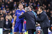 Branislav Ivanovic of Chelsea receives instructions from Jose Mourinho (Manager) of Chelsea during the UEFA Champions League group match between Chelsea and FC Porto at Stamford Bridge, London, England on 9 December 2015. Photo by David Horn / PRiME