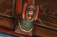 Carved and painted roof bracket with head of man with open mouth wearing a hood, architectural detail of the painted wooden ceiling in the shape of a boat's hull, in the Salle des Povres or Room of the Poor, almost 50m long, in Les Hospices de Beaune, or Hotel-Dieu de Beaune, a charitable almshouse and hospital for the poor, built 1443-57 by Flemish architect Jacques Wiscrer, and founded by Nicolas Rolin, chancellor of Burgundy, and his wife Guigone de Salins, in Beaune, Cote d'Or, Burgundy, France. The hospital was run by the nuns of the order of Les Soeurs Hospitalieres de Beaune, and remained a hospital until the 1970s. The building now houses the Musee de l'Histoire de la Medecine, or Museum of the History of Medicine, and is listed as a historic monument. Picture by Manuel Cohen