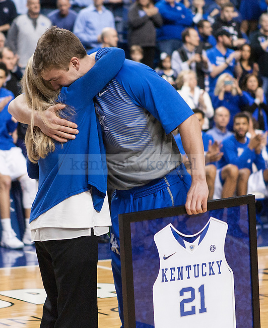 Senior guard Tod Lanter of the Kentucky Wildcats hugs his mother Joy Lanter during the game against the Florida Gators at Rupp Arena on Saturday, March 7, 2015 in Lexington, Ky. Kentucky leads Florida 30-27 at the half. Photo by Michael Reaves | Staff.