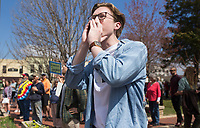 NWA Democrat-Gazette/CHARLIE KAIJO Brad Watson, 18, of Fayetteville shouts exchanges with counter protestors during the &quot;March For Our Lives&quot; rally, Saturday, March 24, 2018 at the Bentonville Square in Bentonville. <br /> <br /> &quot;I want to teach one day and I want a safer future for children and myself,&quot; he said. &quot;I think the goal is to help bring awareness through organized political action.&quot;<br /> <br /> &ldquo;March For Our Lives&rdquo; is a march against gun violence. &quot;[We're] just a group of kids who got together one day and wanted to make a change,&quot; said Taylor Gibson, 16, a student at Bentonville West High School. She is one of nine students from area high schools including Bentonville West, Bentonville High, Gravette and Haas Hall who organized the rally. The rally is in solidarity with more than 800 protests around the world according to &quot;March For Our Lives&quot; organizers