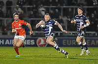 Sale Sharks Josh Charnley breaks through chased by Saracens's No 13 Marcelo Bosch during the European Rugby Champions Cup match between Sale Sharks and Saracens at AJ Bell Stadium, Salford, England on 18 December 2016. Photo by Paul Bell.