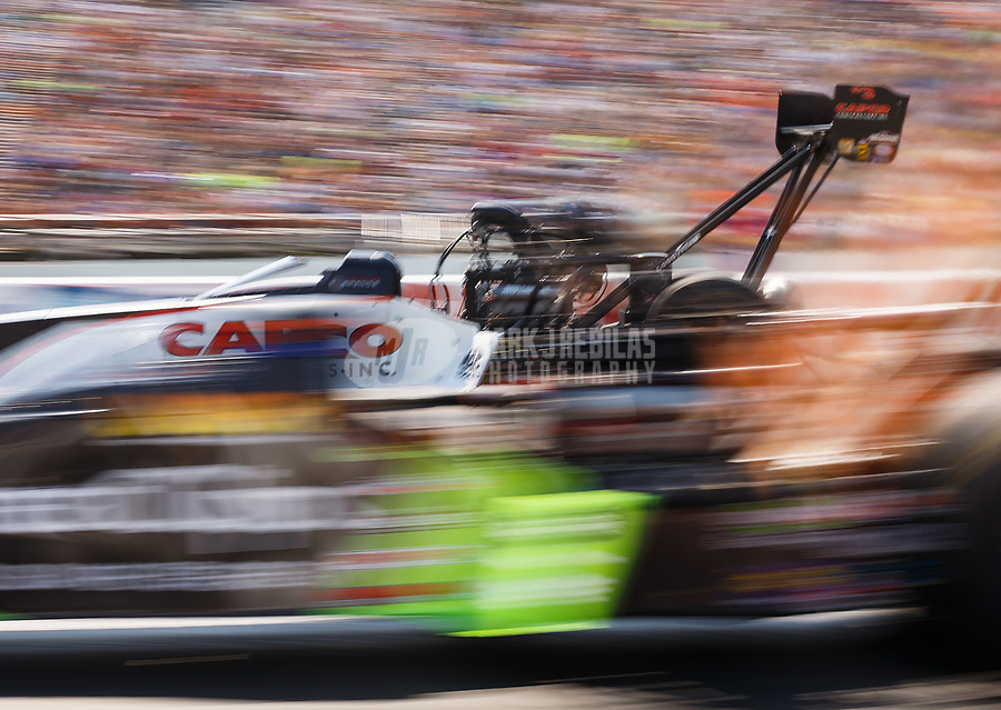 Aug 19, 2017; Brainerd, MN, USA; NHRA top fuel driver Steve Torrence races down track during qualifying for the Lucas Oil Nationals at Brainerd International Raceway. Mandatory Credit: Mark J. Rebilas-USA TODAY Sports