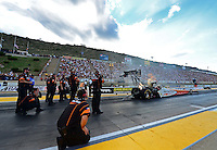 Jul, 20, 2012; Morrison, CO, USA: Crew members look on as NHRA top fuel dragster driver Clay Millican launches off the starting line during qualifying for the Mile High Nationals at Bandimere Speedway. Mandatory Credit: Mark J. Rebilas-US PRESSWIRE