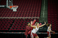 FRESNO, CA--Joslyn Tinkle works off the defense provided by Assistant Coach Trina Patterson during an off-day practice at the Save Mart Center for the 2012 NCAA Championships.