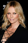 """BEVERLY HILLS, CA. - September 22: Actress Charlize Theron arrives at a special screening of """"Battle in Seattle"""" held at the Clarity Theater on Monday September 22, 2008 in Beverly Hills, California. (Photo by Jeffrey Mayer/WireImge) *** Local caption ***"""