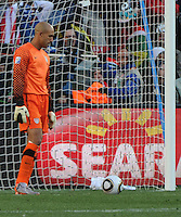Goalkeeper glares at the ball which had just given Slovenia a 1-0 lead early in the first half. The United States came from a 2-0 halftime deficit to Slovenia to earn a 2-2 draw their second match of play in Group C of the 2010 FIFA World Cup.