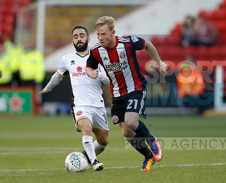 Mark Duffy of Sheffield Utd skips past Erhun Oztumer of Walsall during the Carabao Cup First Round match at Bramall Lane Stadium, Sheffield. Picture date: August 9th 2017. Pic credit should read: Simon Bellis/Sportimage