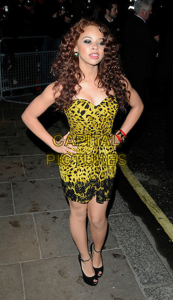 ALEXIS JORDAN .At the BRIT Awards 2011 Universal after party, The Savoy hotel, London, England, UK, .February 15th 2011..Brits full length strapless green yellow leopard animal print dress hands on hips peep toe shoes ankle strap .CAP/CAN.©Can Nguyen/Capital Pictures.