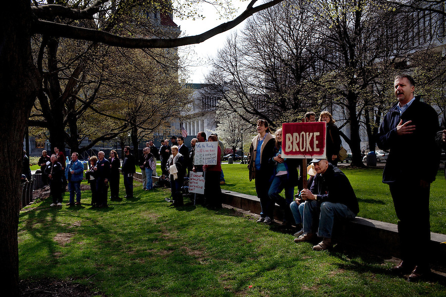 "Albany, New York, April 13, 2010 - Tea Party supporters numbering around 200 joined a Tea Party Express rally outside the State Capitol building. The 43-city Tea Party Express tour titled ""Just Vote Them Out"" is taking an aggressive approach by targeting Democratic incumbents competitive districts, as well as Republicans deemed not conservative enough who are facing primary challenges from more conservative candidates. While not endorsing any candidates so far, the Tea Party Express does not hide its desire to replace incumbents with new conservatives that more closely hew to its goals of smaller government and less taxes.."