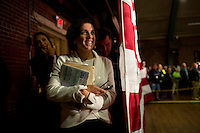 Vanessa Sinders, chief of staff for Senator Scott Brown (R-MA), listens to a campaign rally backstage at the American Civic Center in Wakefield, Massachusetts, USA, on Thurs., Nov. 2, 2012. Senator Scott Brown is seeking re-election to the Senate.  His opponent is Elizabeth Warren, a democrat.