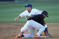 Scott Wingo #14 of the Rancho Cucamonga Quakes tags out Billy Hamilton #4 the Bakersfield Blaze at second base on a stolen base attempt at The Epicenter on June 21, 2012 in Rancho Cucamonga, California. Bakersfield defeated Rancho Cucamonga 12-2. (Larry Goren/Four Seam Images)
