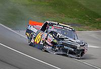 Feb 21, 2009; Fontana, CA, USA; NASCAR Camping World Truck Series driver Brian Scott after crashing during the San Bernardino County 200 at Auto Club Speedway. Mandatory Credit: Mark J. Rebilas-