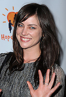 "WEST HOLLYWOOD, CA - APRIL 14:  Jessica Stroup at the ""Road to Hope"" charity event at Bootsy Bellows on April 14, 2014 in West Hollywood, California. (Photo by PGSK/Starlitepics.)"
