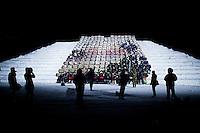 """Kirkenes, Norge, 09.02.2012. Et bildespill regissert av Morten Traavik og dirigert av Ri Gwang Nam. Ri Gwang Nam er Arirang koordinator. Den 1. februar 2012 lastet kunstner Morten Traavik opp en videosnutt på You Tube av Nord-Koreanske ungdommer som spiller A-Ha hiten """"Take on Me"""" på trekkspill. En uke etter ha over en million mennesker sett videoen. En delegasjon Nord-Koreanere er i Kirkenes i forbindelse med festivalen """"Barents Spetakel"""". Foto: Christopher Olssøn"""
