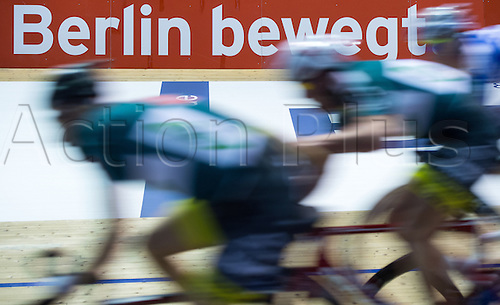 22.01.2015. Beling, Germany. Berlin 6-Day cycing tour championships.  Cyclists ride past the words 'Berlin moves' at the 104th Berlin 6-Day Race