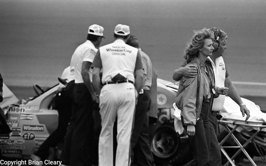 Ricky Rudd's wife Lind is led away from his crash accident in Busch Clash at Daytona International Speedway in Daytona Beach, FL on February  1984. (Photo by Brian Cleary/www.bcpix.com)