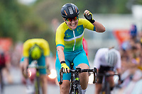 Picture by Alex Whitehead/SWpix.com - 14/04/2018 - Commonwealth Games - Cycling Road - Currumbin Beachfront, Gold Coast, Australia - Chloe Hosking of Australia celebrates winning Gold in the Women's Road Race ahead of Georgia Williams of New Zealand and Dani Rowe of Wales.