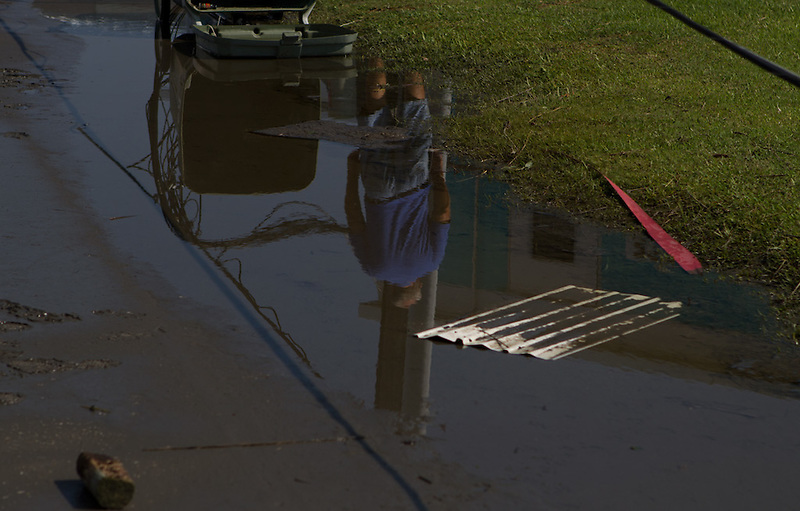 Wallace Stevens wades through standing water to survey the damage to mobile homes in Triple S Marina Village, in Atlantic Beach, N.C. One trailer was demolished during the high winds and rain of Hurricane Irene, which made landfall in the area early Saturday morning. The majority of the trailers in this park sustained only minor damages, mostly to their roofs and awnings. ..Atlantic Beach was largely spared from the worst of the storm, but residents are likely to remain without power until crews can repair feeds to the area. The bridge to the island was opened upon surveillence of the damage and the beginnings of power restoration.