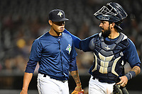 Pitcher Darwin Ramos (33) of the Columbia Fireflies is congratulated by catcher Ali Sanchez in a game against the West Virginia Power on Thursday, May 18, 2017, at Spirit Communications Park in Columbia, South Carolina. Columbia won in 10 innings, 3-2. (Tom Priddy/Four Seam Images)