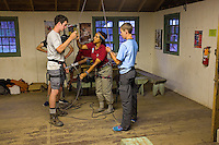 Photo story of Philmont Scout Ranch in Cimarron, New Mexico, taken during a Boy Scout Troop backpack trip in the summer of 2013. Photo is part of a comprehensive picture package which shows in-depth photography of a BSA Ventures crew on a trek.  In this photos BSA Venture Crew members get additional belay training prior to climbing on the natural rock surfaces at the  Cimarroncito Camp in the backcountry at Philmont Scout Ranch.   <br /> <br /> <br /> The  Photo by travel photograph: PatrickschneiderPhoto.com